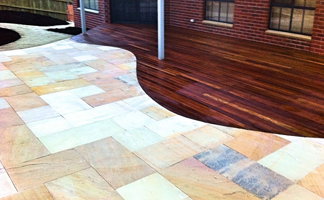 Spotted gum deck curved into sawn sandstone paving