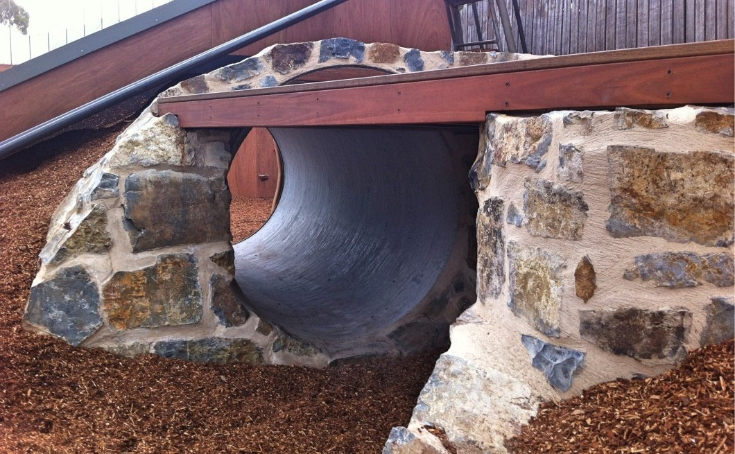 Tunnel under slippery slide