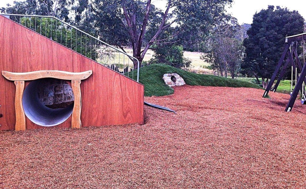 School playground slippery slide and Hobbit hole
